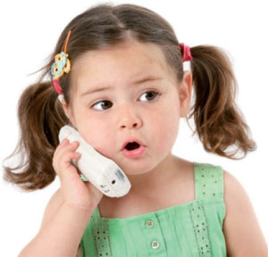 child talking on telephone