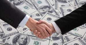 lobbyist handshake over money