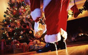 santa places presents under tree